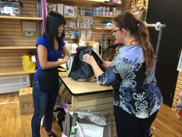 Fumiko MacPherson. left, checks out the items brought in by a patron who did not want to be identified. MacPherson owns and operates Kid To Kid, 9326 W. Sahara Ave., Suite 2, one of the newest sto ...