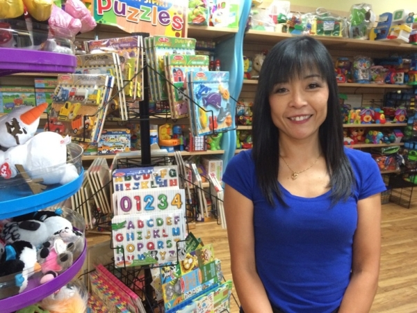 Fumiko MacPherson pauses by a toy display Aug. 11 at her store, Kid To Kid, 9326 W. Sahara Ave., Suite 2, in Village Square. The store moved to the new location in April and saw an 85 percent incr ...