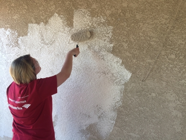 A volunteer paints the outside of a Henderson home Oct. 10, 2015. Approximately 25 Bank of America employees painted the exterior of two homes in Henderson as part of Habitat for Humanity Las Vega ...