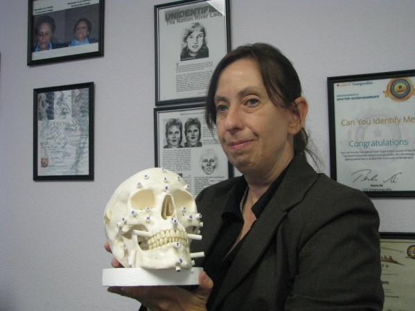 Rebel Morris, founder and executive director of Can You Identify Me explains facial recioonstruction from a skull at her office at 405 Max Court,  Ste 240,  Henderson. (F. Andrew Taylor/View)