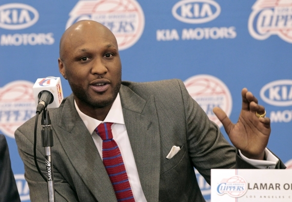 Basketball player Lamar Odom speaks at a news conference announcing his acquisition by the Los Angeles Clippers in Los Angeles, California in this July 2, 2012, file photo. Odom was hospitalized o ...