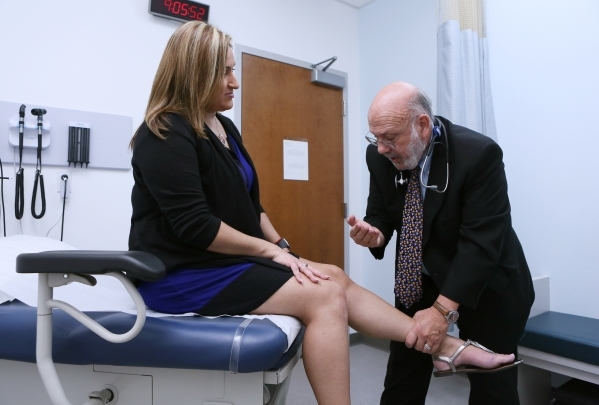 Dr. Mitchell Forman, right, examines patient Jeanne Zelaya at Touro University Nevada on Friday, Oct. 16, 2015, in Henderson. Dr. Forman is the founding dean of the Touro University Nevada College ...