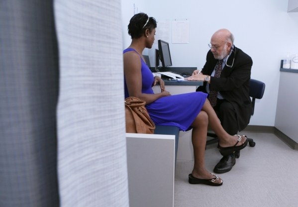 Dr. Mitchell Forman, right, speaks with patient Tami Best during an appointment at Touro University Nevada on Friday, Oct. 16, 2015, in Henderson. Dr. Forman is the founding dean of the Touro Univ ...
