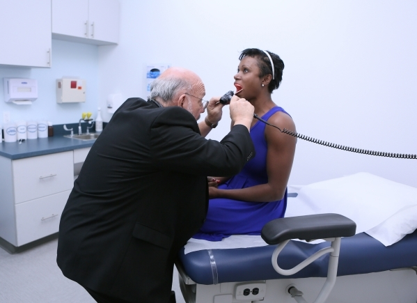 Dr. Mitchell Forman, left, examines patient Tami Best at Touro University Nevada on Friday, Oct. 16, 2015, in Henderson. Dr. Forman is the founding dean of the Touro University Nevada College of O ...