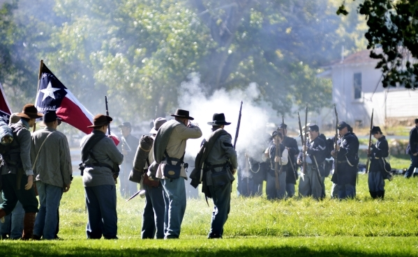 Confederate troops, at left, fire on Union forces at Spring Mountain Ranch State Park on Saturday, Oct. 24, 2015.  (Bill Hughes/Las Vegas Review-Journal)
