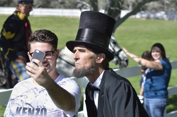 Marco Cacciotti, left, takes a selfie with Robert Broski as Abraham Lincoln at Spring Mountain Ranch State Parkon Saturday, Oct. 24, 2015. (Bill Hughes/Las Vegas Review-Journal)