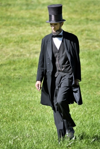 Robert Broski, as Abraham Lincoln, walks across a field after a battle at Spring Mountain Ranch State Park on Saturday, Oct. 24, 2015. (Bill Hughes/Las Vegas Review-Journal)