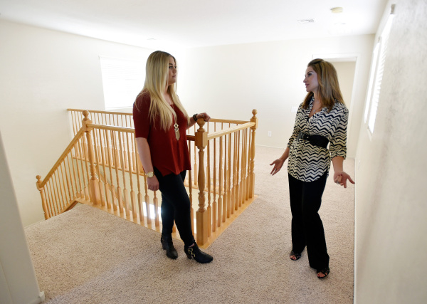 Property manager Ashley Hawks, right, speaks with her client Cassie Davis as they tour a rental home in Henderson on Tuesday, Oct. 20, 2015. David Becker/Las Vegas Review-Journal