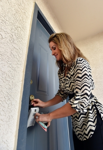 Property manager Ashley Hawks locks up a rental home in Henderson after showing it to a potential renter on Tuesday, Oct. 20, 2015, in Henderson. David Becker/Las Vegas Review-Journal