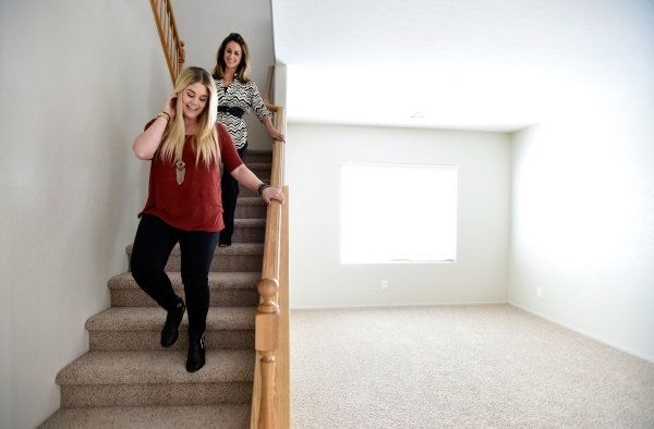 Property manager Ashley Hawks, right, escorts her client Cassie Davis through a rental home in Henderson on Tuesday, Oct. 20, 2015. David Becker/Las Vegas Review-Journal