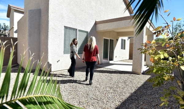 Property manager Ashley Hawks, left, speaks with her client Cassie Davis as they tour a rental home in Henderson on Tuesday, Oct. 20, 2015. David Becker/Las Vegas Review-Journal