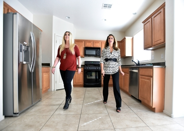 Property manager Ashley Hawks, right, escorts her client Cassie Davis as they tour a rental home in Henderson on Tuesday, Oct. 20, 2015. David Becker/Las Vegas Review-Journal
