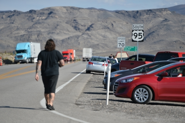 A motorist returns to his car as Nye County Sheriff and NHP officers divert traffic from U.S. Highway 95 to Nevada State Route 160 on Monday, Oct. 19, 2015, north of Las Vegas. Brett LeBlanc/Las V ...
