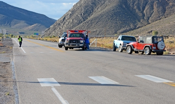 A road block is seen on U.S. Highway 95 south of Beatty, Nev. Monday, Oct. 29, 2015. A 140-mile stretch of Nevada's main north-south highway closed because of a fire at a hazardous waste dum ...