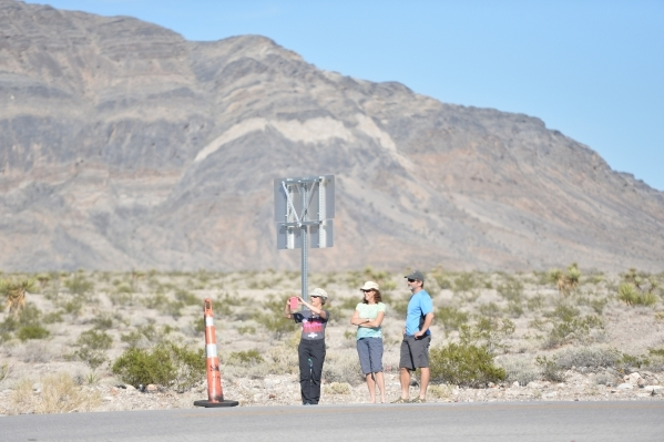 Motorists take photos as Nye County Sheriff and NHP officers divert traffic from U.S. Highway 95 to Nevada State Route 160 on Monday, Oct. 19, 2015, north of Las Vegas. Brett LeBlanc/Las Vegas Rev ...