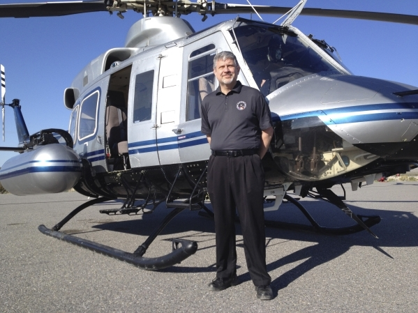 Alan Remick, aerial measuring system program manager for the National Nuclear Security Administration stands by the agency's Bell-412 helicopter Tuesday, March 25, 2014,  at Desert Rock Airp ...