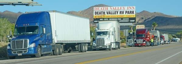 Tractor-trailers are seen parked along southbound U.S. Highway 95 in Beatty, Nev. as drivers wait for the highway to reopen Monday, Oct. 29, 2015. A 140-mile stretch of Nevada's main north-s ...
