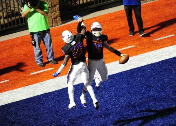 Bishop Gorman wide receiver/defensive back Tyjon Lindsey (25) and quarterback Tate Martell (18) celebrate after Martell scored a touchdown against Don Bosco in the second half of their prep footba ...