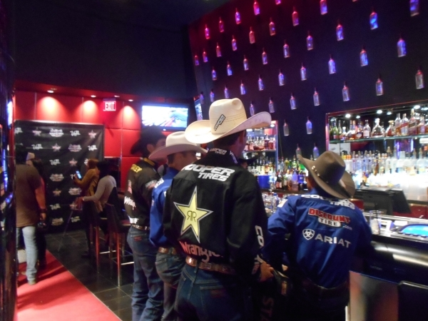 Professional Bull Riders competitors belly up to the bar at the Rouge lounge inside MGM Grand hotel-casino Tuesday afternoon for Media Day in anticipation of the PBR World Finals at Thomas & M ...