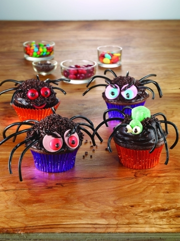 Cupcakes become spiders with the addition of shoestring licorice, gumdrops and other candies. (courtesy McCormick & Co.)