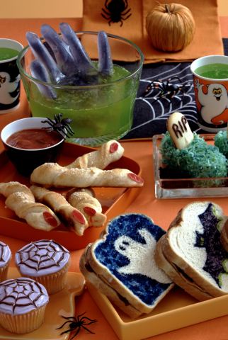 Make a delightfully sickening green punch, and you can float a purple hand in it. Halloween is the perfect time to have fun with such spooky creations as Bewitching Breadsticks, center left, and c ...