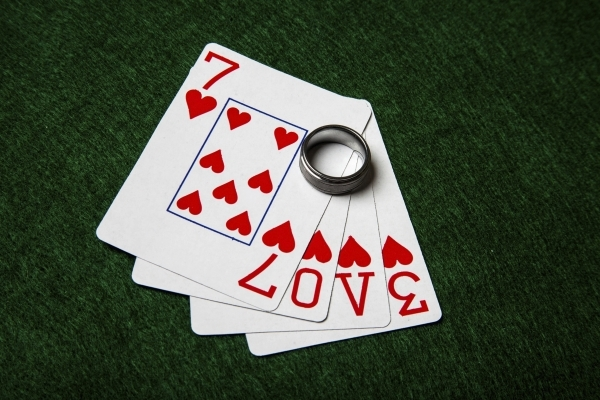 Love cards and wedding ring.
