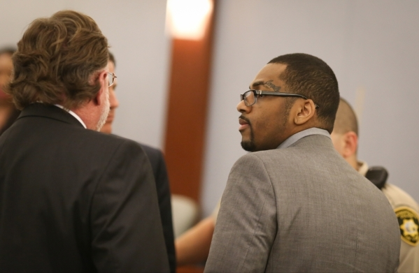 Defendant Ammar Harris, right, speaks with his counsel at the Clark County District Court at the Regional Justice Center Thursday, Oct. 22, 2015, in Las Vegas. Harris could face the death penalty  ...