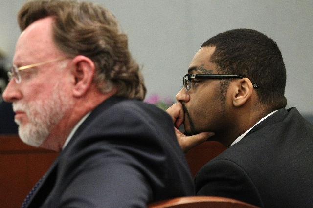 Ammar Harris, right, who is accused of killing three people on the Strip, sits in court for closing statements in his trial at the Regional Justice Center in Las Vegas Monday, Oct. 26, 2015. Erik  ...