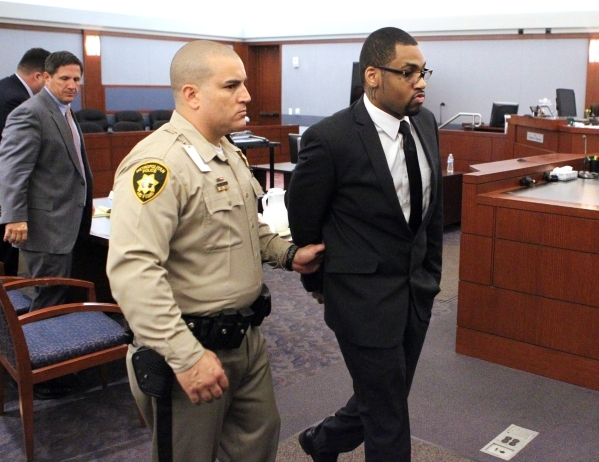 Ammar Harris, right, is led out of the courtroom Monday, Oct. 26, 2015, after being found guilty on all counts in his murder trial stemming from a Feb. 21, 2013, shooting and a fiery crash that ki ...