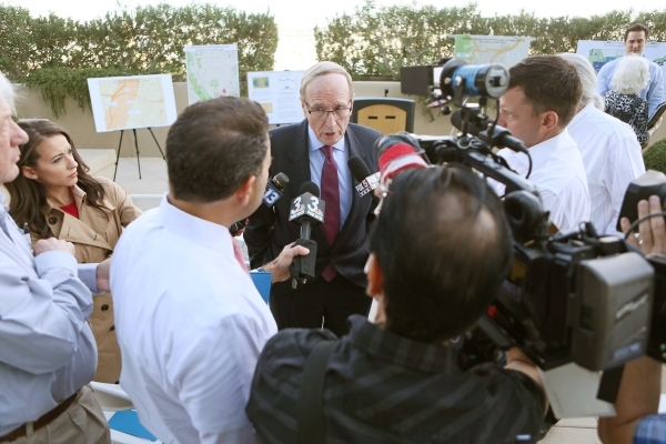 Former U.S. Sen. Richard Bryan, center, chairman of the Nevada Commission on Nuclear Projects, speaks to the news medai at Molasky Building Tuesday, Oct. 27, 2015, in Las Vegas. Las Vegas was one  ...