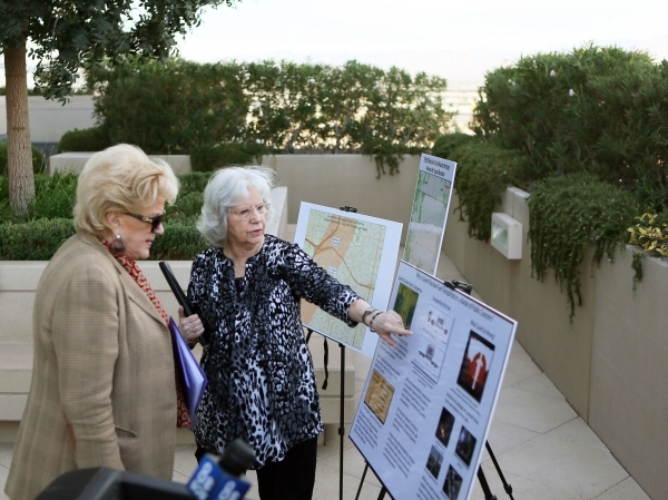 Judy Treichel, right, executive director of Nevada Nuclear Waste Task Force, speaks with Mayor Carolyn Goodman at a nuclear waste transportation summit news conference at Molasky Building Tuesday, ...