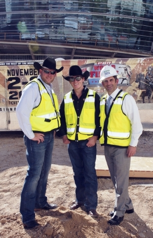 Sean Gleason, CEO of the Professional Bull Riders, from left, bull rider Reese Cates and Rick Arpin, Senior Vice President of Entertainment and Development for MGM Resorts pose in front of the new ...