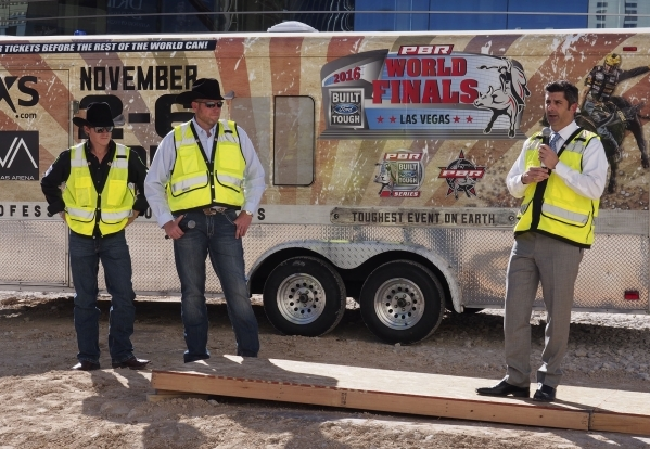 Rick Arpin, Senior Vice President of Entertainment and Development for MGM Resorts, right, discusses the upcoming Professional Bull Riders move to the new MGM Resorts arena from the Thomas & M ...