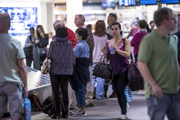 Travelers wait in baggage claim at McCarran International Airport in Las Vegas on Tuesdsay, Oct. 27, 2015. Joshua Dahl/Las Vegas Review-Journal