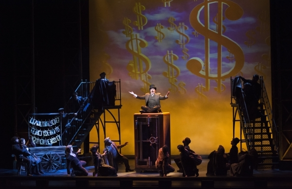 Todd Berkich, as J.P. Morgan, seated on safe, performs with other cast members from ìRagtimeî at Reynolds Hall in the Smith Center for the Performing Arts at 361 Symphony Park Ave. in Las Ve ...