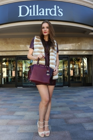 Katielle Nietzke wearing Vince Camuto leather dress, Calvin Klein faux fur vest and Michael Kors handbag provided by Dillard's at Downtown Summerlin.