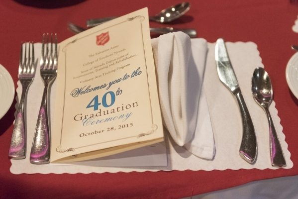 The program is shown during the 40th graduation ceremony for The Salvation Army's Lied Vocational Program at Russell's Restaurant at College of Southern Nevada Cheyenne campus in North ...