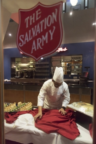 Chef Levy Acosta sets a buffet table during the 40th graduation ceremony for The Salvation Army's Lied Vocational Program at Russell's Restaurant at College of Southern Nevada Cheyenne ...
