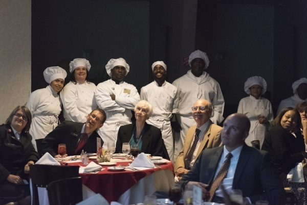 Graduates and diner attendees watch a slideshow during the 40th graduation ceremony for The Salvation Army's Lied Vocational Program at Russell's Restaurant at College of Southern Neva ...