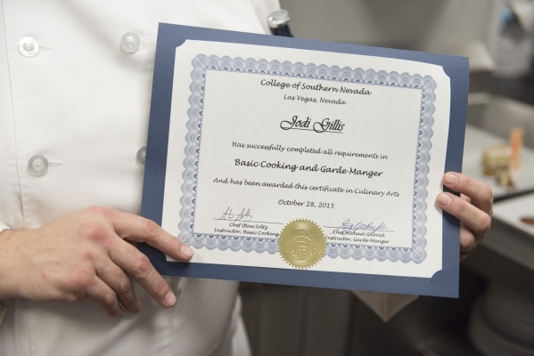 Jodi Gillis poses with her certificate of completion during the 40th graduation ceremony for The Salvation Army's Lied Vocational Program at Russell's Restaurant at College of Southern ...
