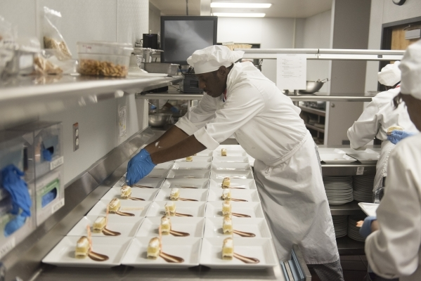 Alfonso Highsmith prepares Lemon Cake Delight during the 40th graduation ceremony for The Salvation Army's Lied Vocational Program at Russell's Restaurant at College of Southern Nevada ...