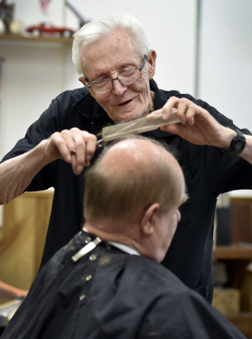 Barber Jerry Stump shares a laugh with his customer, Tim Vanca, as he trims his hair at the West Hill Barber Shop on Tuesday, Oct. 27, 2015, in Las Vegas. Stump, a Las Vegas resident since 1942, h ...