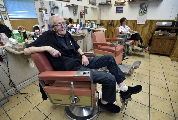 Barber Jerry Stump relaxes in one of his barber chairs as he waits for customers at his West Hill Barber Shop on Tuesday, Oct. 27, 2015, in Las Vegas. Stump, a Las Vegas resident since 1942, has b ...