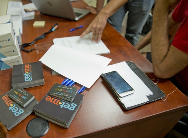 Potential employees are walked through paperwork during an employee intake event for Get Me, a new ridehail company, near Sandhill Road and Patrick Lane in Las Vegas on Tuesday, Oct. 27, 2015. Dan ...