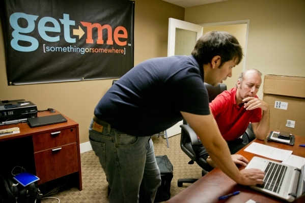 Matt Krueger, left, walks potential driver Simon Swinton through paperwork during an employee intake event for Get Me, a new ridehail company, near Sandhill Road and Patrick Lane in Las Vegas on T ...