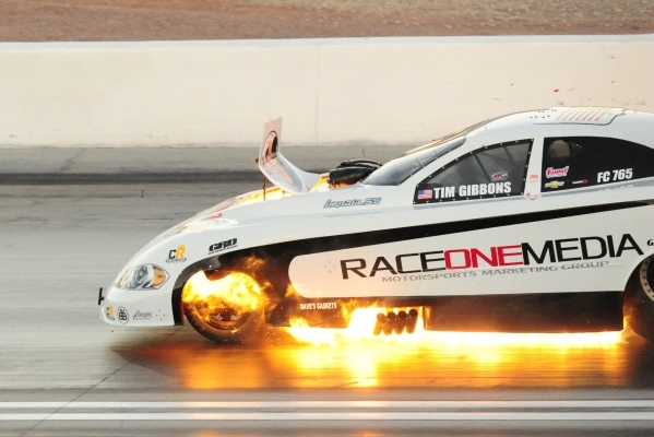 Funny Car driver Tim Gibbons blows his engine during the second round of qualifying for the Mello Yello NHRA Drag Racing Series Toyota Nationals at The Strip at Las Vegas Motor Speedway in Las Veg ...