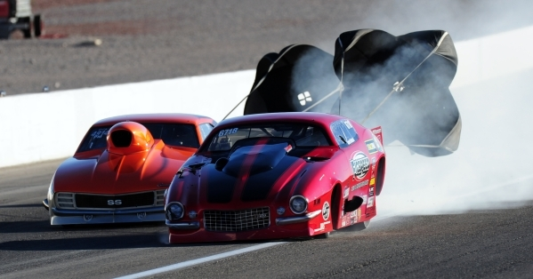 Pro Mod driver Shane Molinari, right, (Battle Ground, Wash.) drifts into the lane occupied by Jeff Naiser (Houston) after a tire blew on Molinari's car during the second round of qualifying  ...