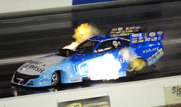 First day No. 1 Funny Car qualifier Tommy Johnson Jr. of Avon, Ind., is seen during the second round of qualifying for the Mello Yello NHRA Drag Racing Series Toyota Nationals at The Strip at Las  ...