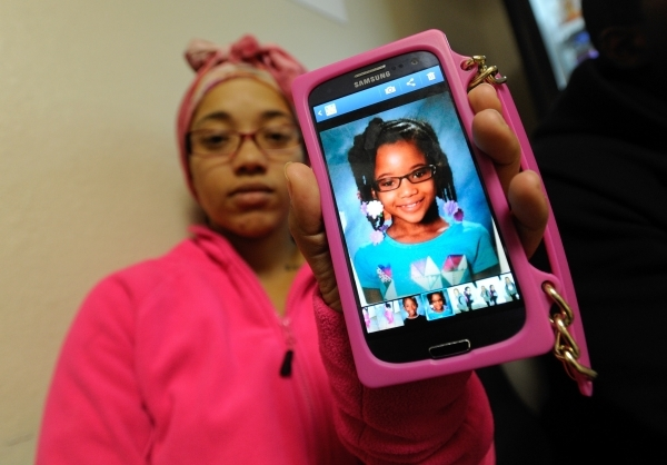 Tiffany Ward displays a photo of her daughter Brazyl Ward, 6, in the waiting area at the University Medical Center  Children's Hospital of Nevada on Tuesday, Nov. 5, 2013. David Becker/Las V ...