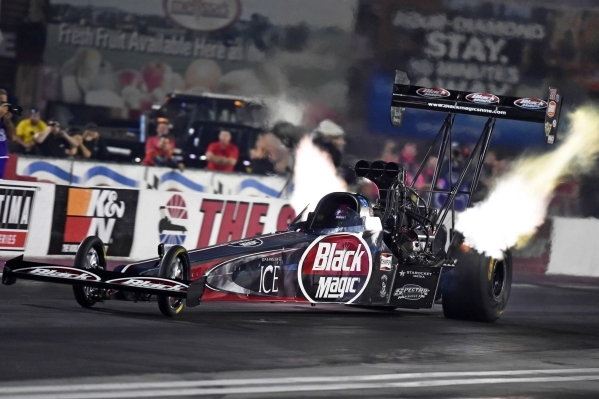 NHRA Top Fuel Dragster driver Leah Pritchett blasts down the strip during a qualifying run at Las Vegas Motor Speedway on Friday night. She made it to the semifinals at last year's Toyota Na ...